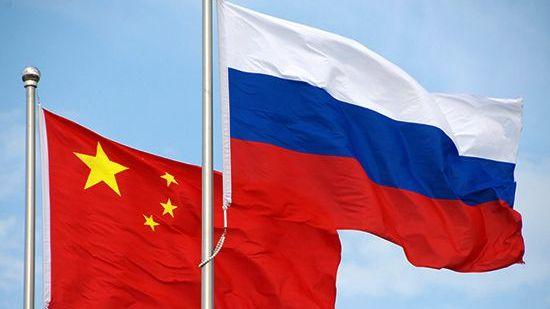 Флаги РФ и КНР