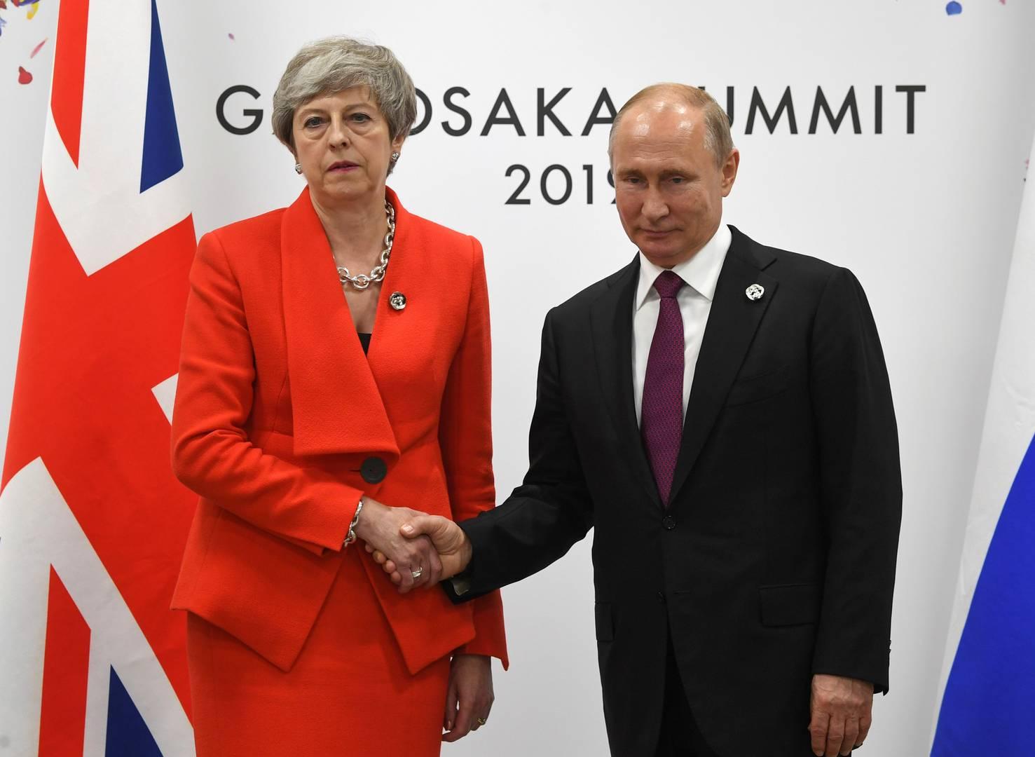 Владимир Путин с премьер-министром Великобритании Терезой Мэй