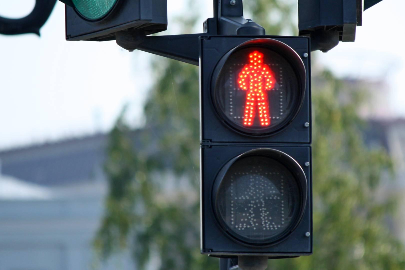 Красный сигнал пешеходного светофора