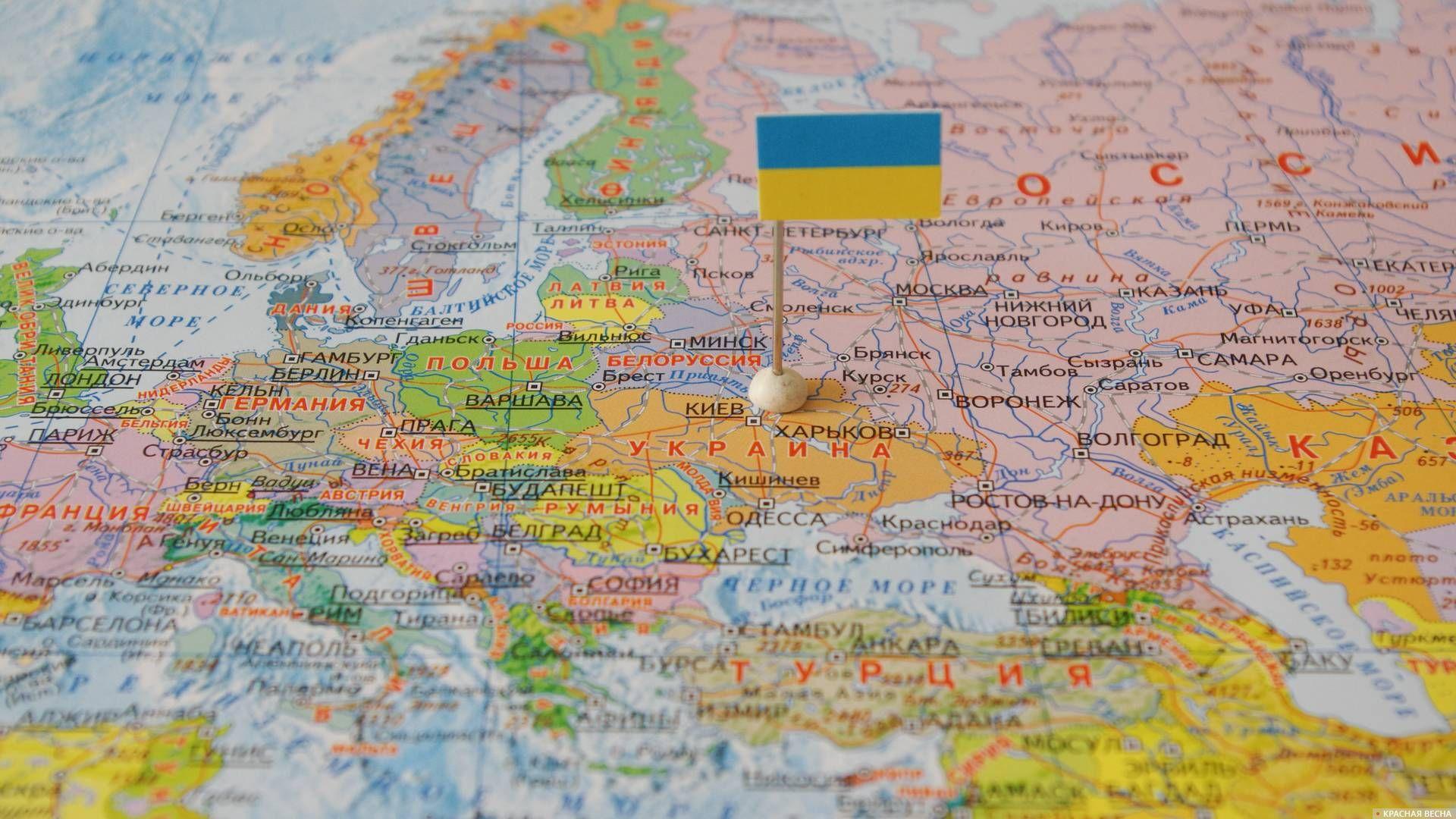 Украина с флагом на карте мира