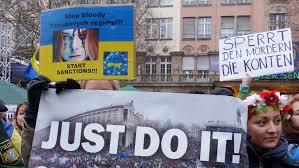 «Start sanctions!!!» на плакате 2014 года в поддержку Евромайдана